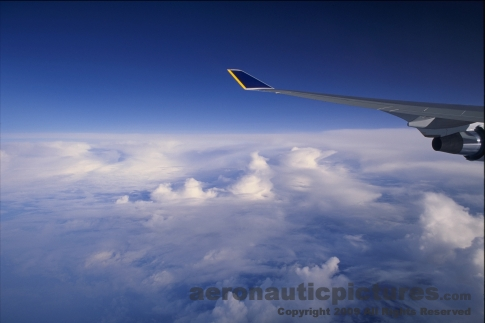 picture of passenger's view of clouds on jet